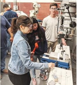 Students (left to right) Yersemi Mayralee Gutierrez, Lizbet Cardenes Pachero, and Yahir Alonso Diaz Medina work on a machining operation. (All images provided by Desert View High School)